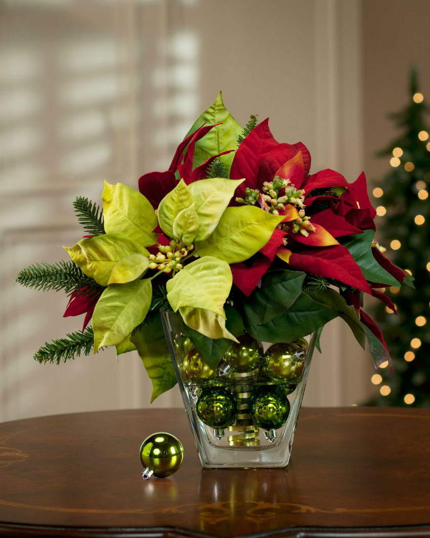 Poinsettias are a classic but you can play with them, too. Image Source: Pinterest