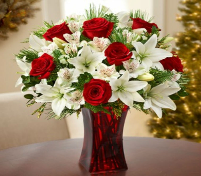White lilies look amazing with red roses. Image Source: Vienna Florist