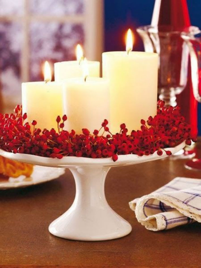 This beautiful centerpiece uses cranberries for a red touch. Image Source: Pink Lover
