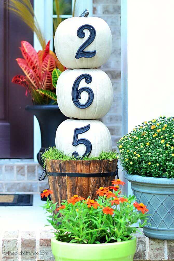 A numbered house with ornate DIY pumpkins