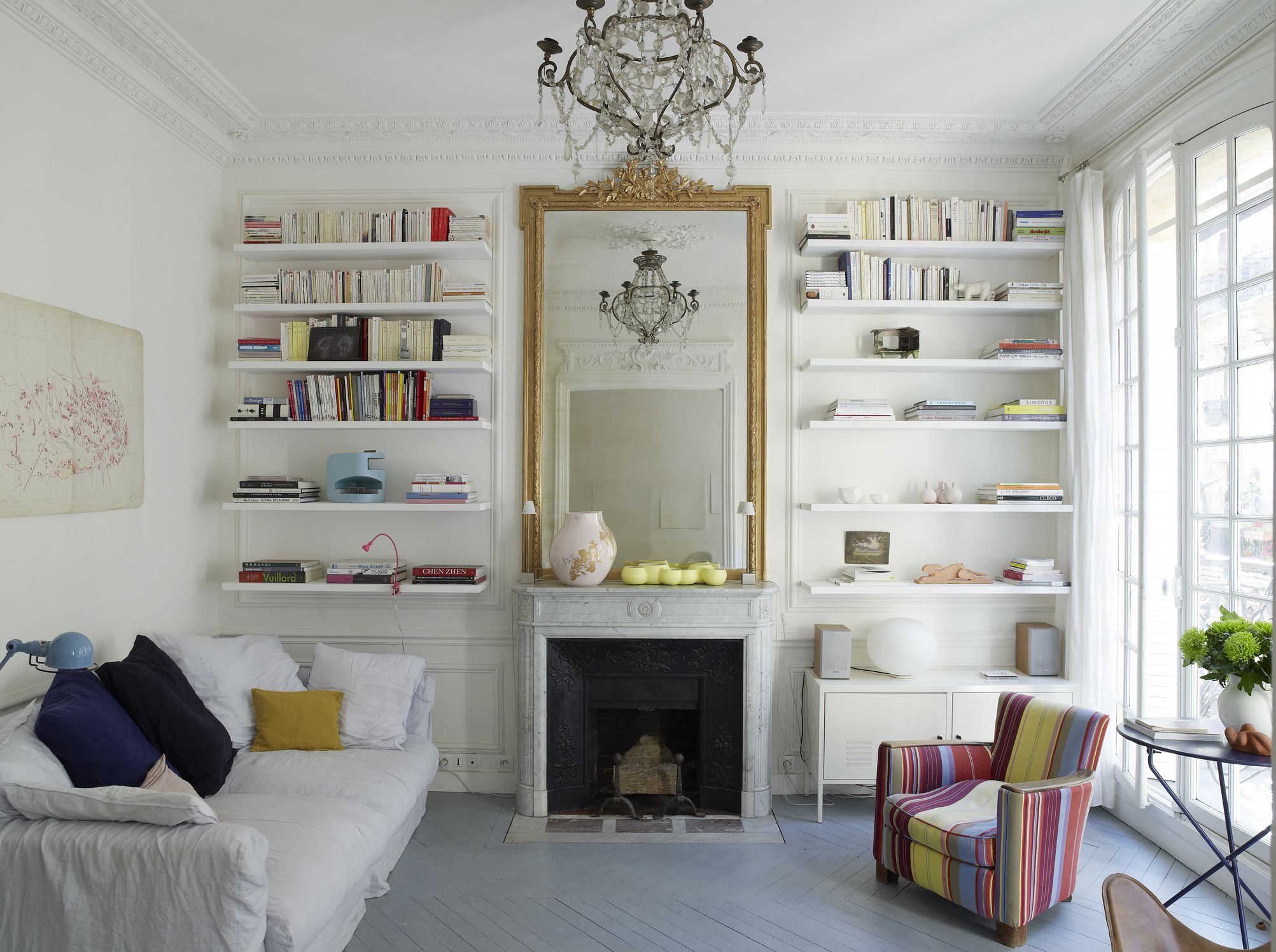 The living room can benefit a lot with mirrors. Source: The Spruce