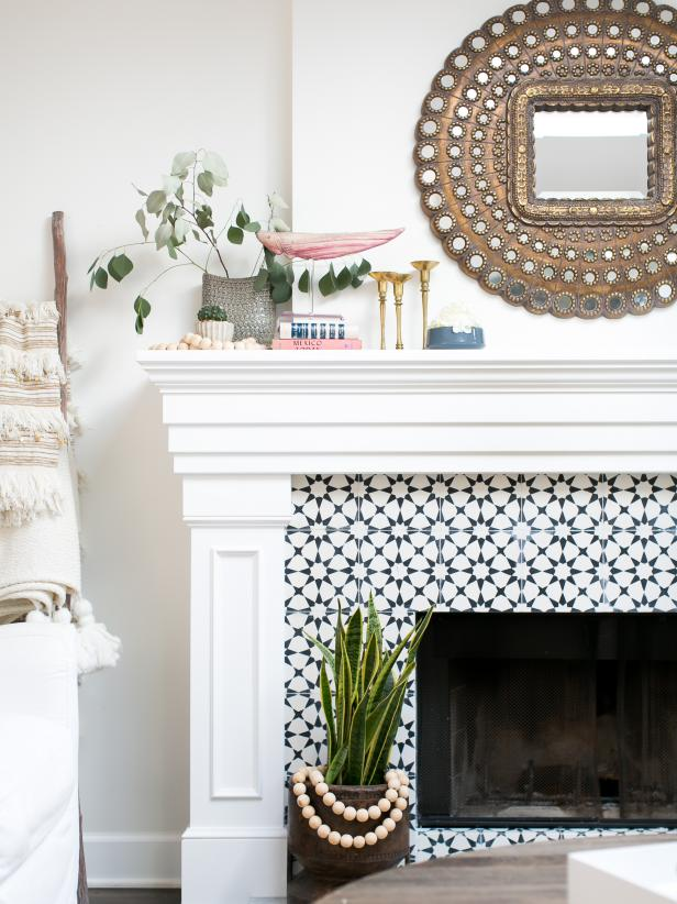 The fireplace can also have a beautiful tiling pattern! Source: HGTV