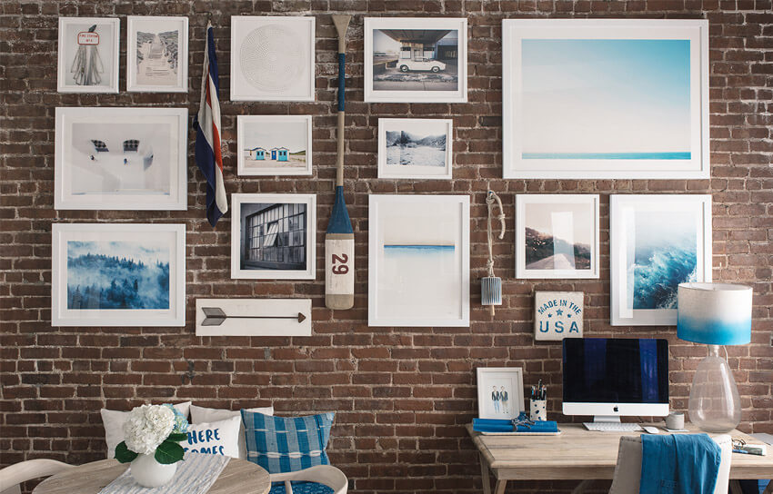An exposed brick wall is the perfect backdrop for a gallery wall.