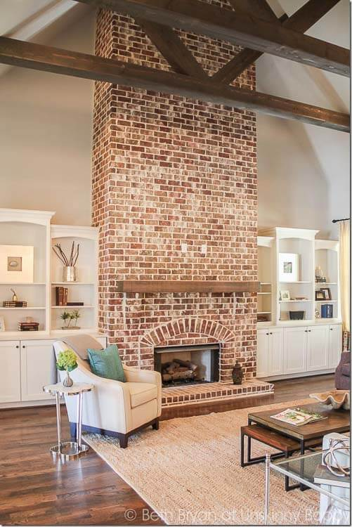 A fireplace is the perfect place to show off exposed brick.