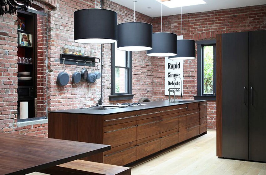 Exposed brick adds an industrial edge to the kitchen.