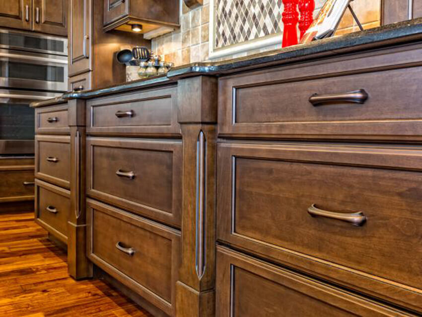 Use equal parts vinegar and warm water to remove grease stains from cabinets.