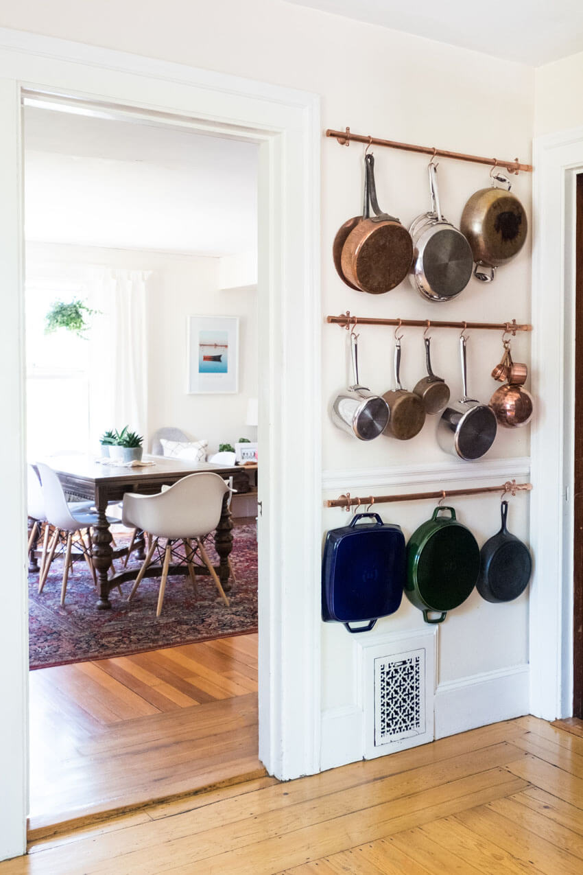 A pot rack, whether on the wall or hanging from the ceiling, will help add space to your small kitchen.