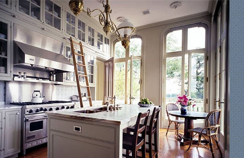 A rolling ladder can help you get to vertical storage in a small kitchen.