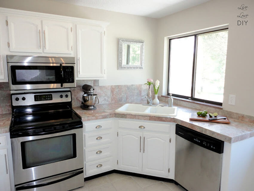 White cabinets reflect light better, making the space feel bigger.