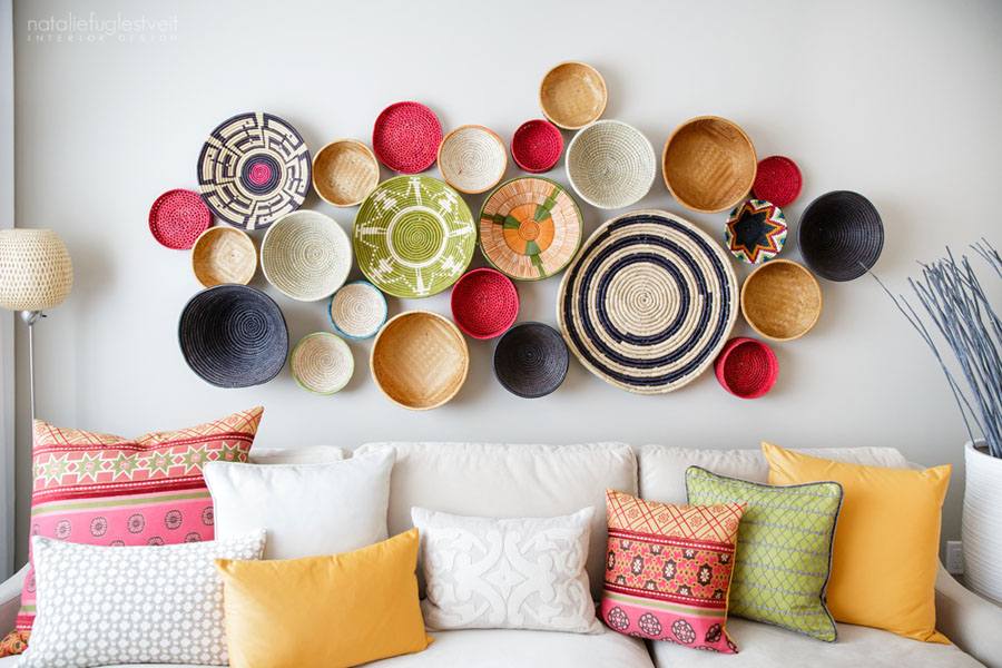 Use baskets or the bottoms of baskets to create unique and colorful wall decor.