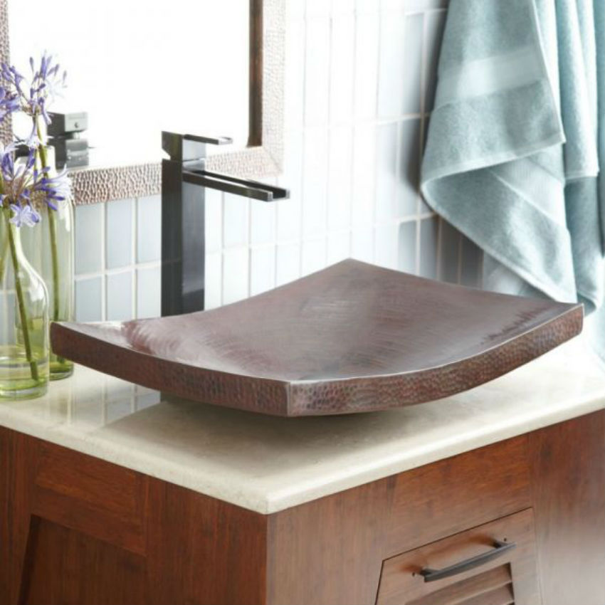This copper sink is at the same time classic and modern as well as elegant and daring. Image Source: Homes and Hues