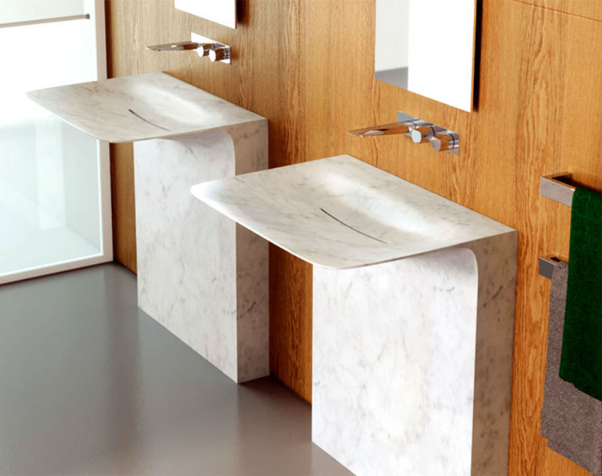 Marble continues to be in, not only as flooring or cladding but also as bathroom accessories. Image Source: Interior Zine