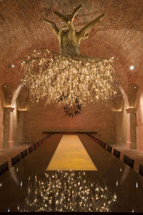 a stunning light fixture that resembles a large grapevine made of swarovski crystal grapes