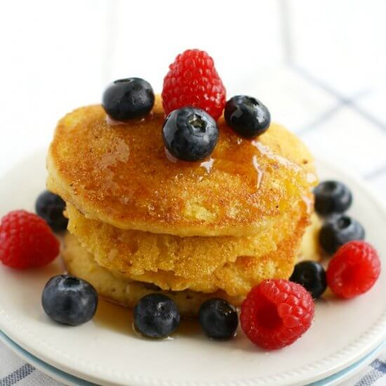 These gluten-free beauties will keep your belly full through  day of work or a day of shoveling. Image source https://www.recipeshubs.com/cornmeal-pancakes-with-berries/25716
