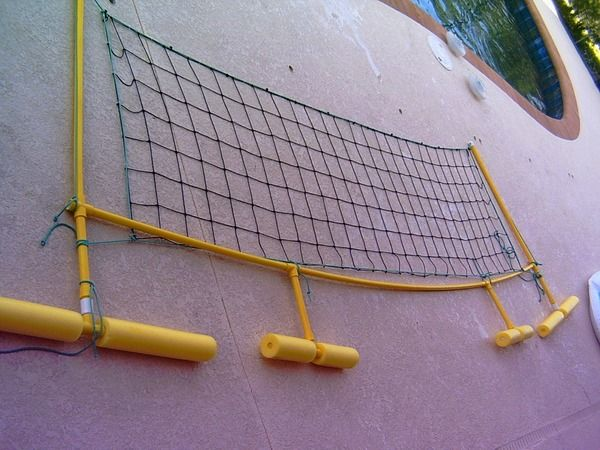 Make your own swimming pool volley ball net out of pool noodles and netting!