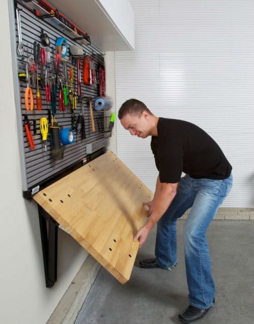 This workbench is great to create a working space in a small garage. Image Source: Bench Solution