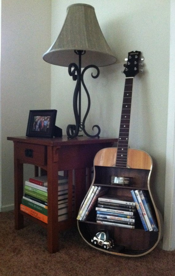 What about displaying your favorite books inside your favorite instrument? Image Source: Top Dreamer