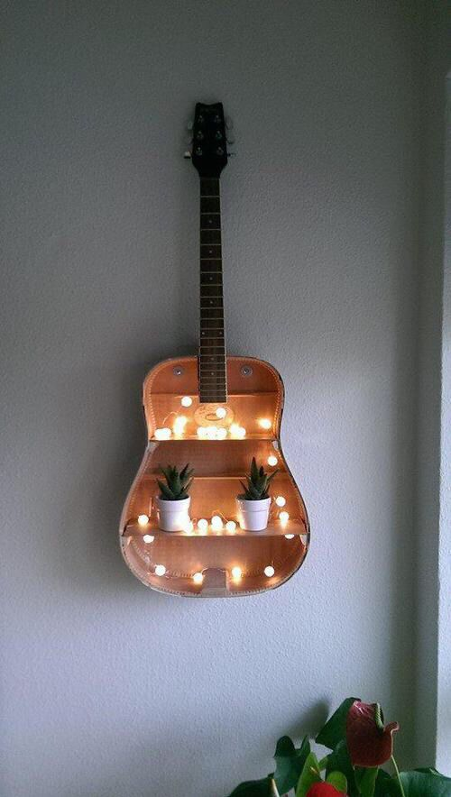 This is a romantic option of turning your old guitar into a piece of decor. Image Source: Top Dreamer