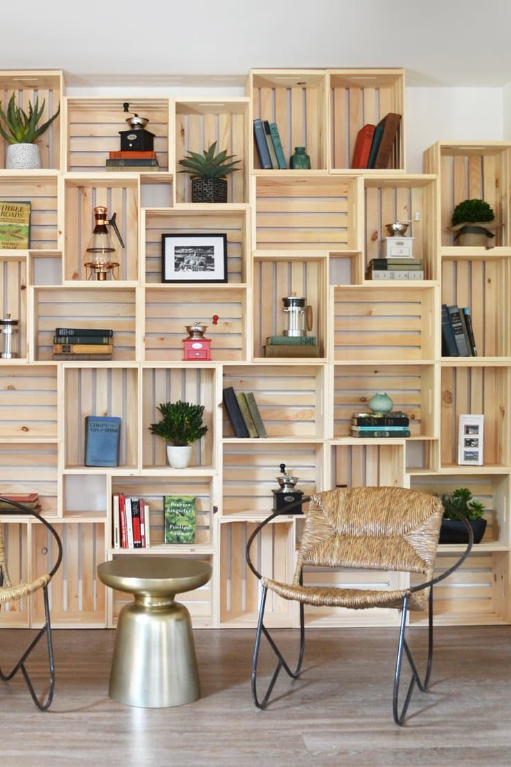 Wood crates make a beautiful wall cover with great storage potential. Via Apartment Therapy.