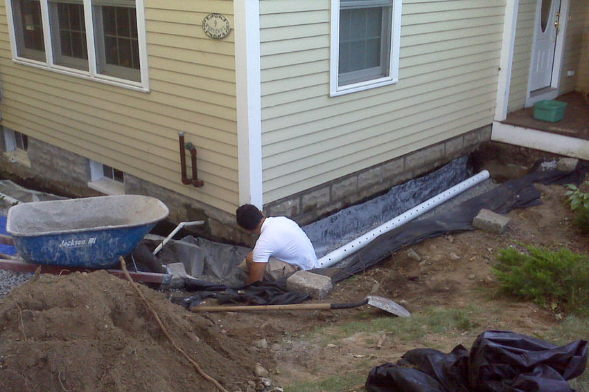 Dig trenches around the foundation to install French drains.
