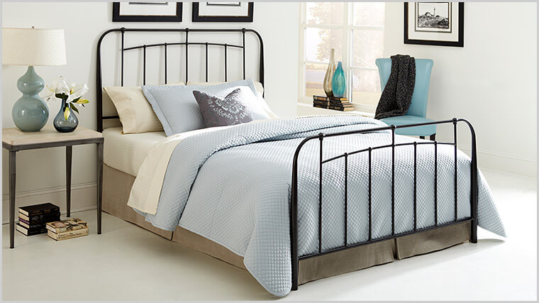 A wrought iron bedframe will really bring in the bedroom