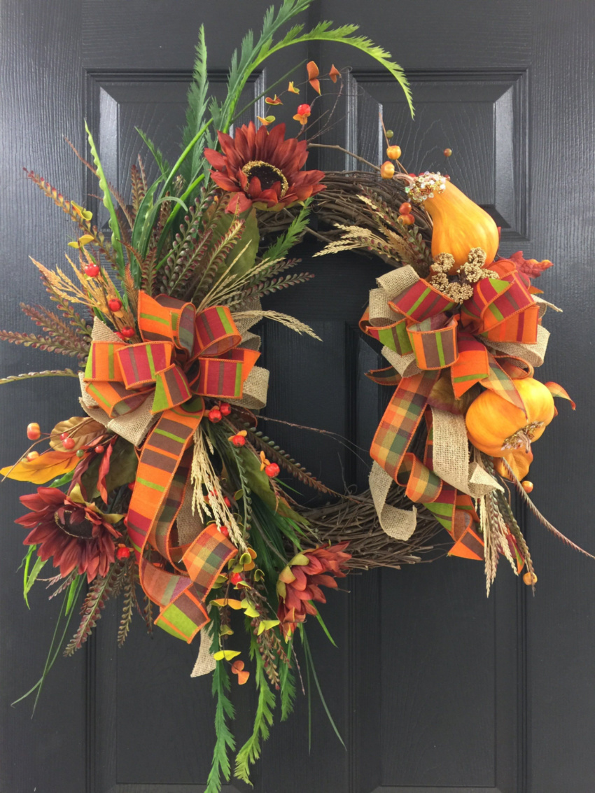 A gorgeous wreath like this will surely improve your front door. Source: Southern Home Accents